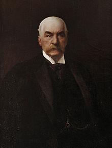 John Pierpont Morgan (17 de abril de 1837 - 31 de marzo de 1913) fue un empresario, banquero y coleccionista de arte estadounidense que dominó las finanzas corporativas y la consolidación industrial de su época. Retrato por Carlos Baca-Flor.